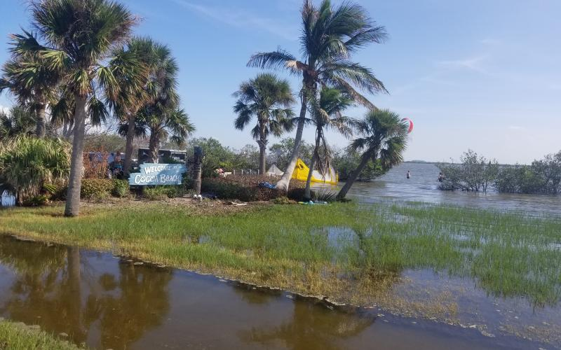 Cocoa Beach Sign Is Under Water Due To Recent Flooding