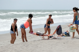 Sunbathers flock to Florida's Cocoa Beach as it reopens