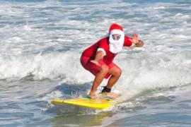 Celebrate Christmas Eve with Hundreds of Surfing Santas on Cocoa Beach